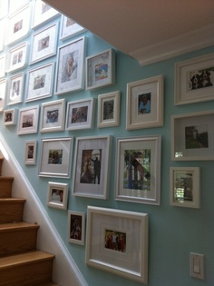 gallery wall staircase blue wall