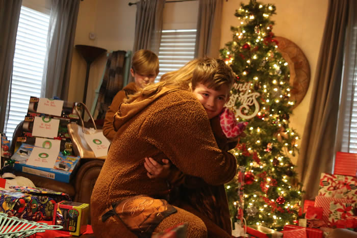 Photos of the kids opening gifts on Christmas morning