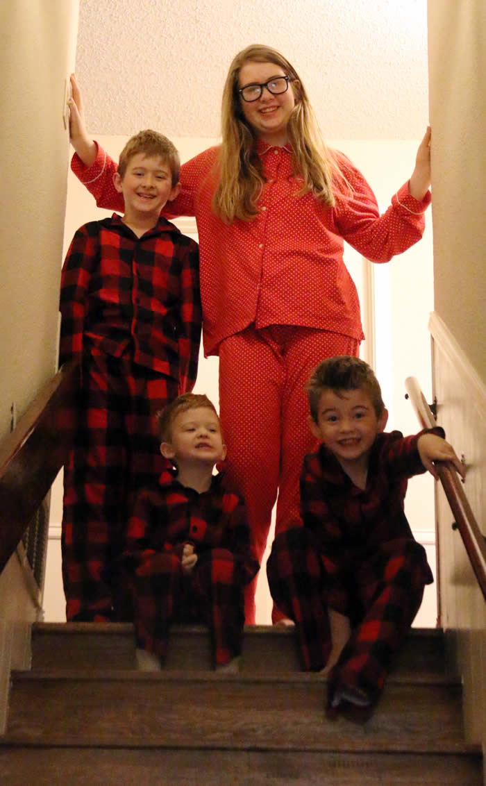 Christmas morning at the top of the stairs waiting for gifts
