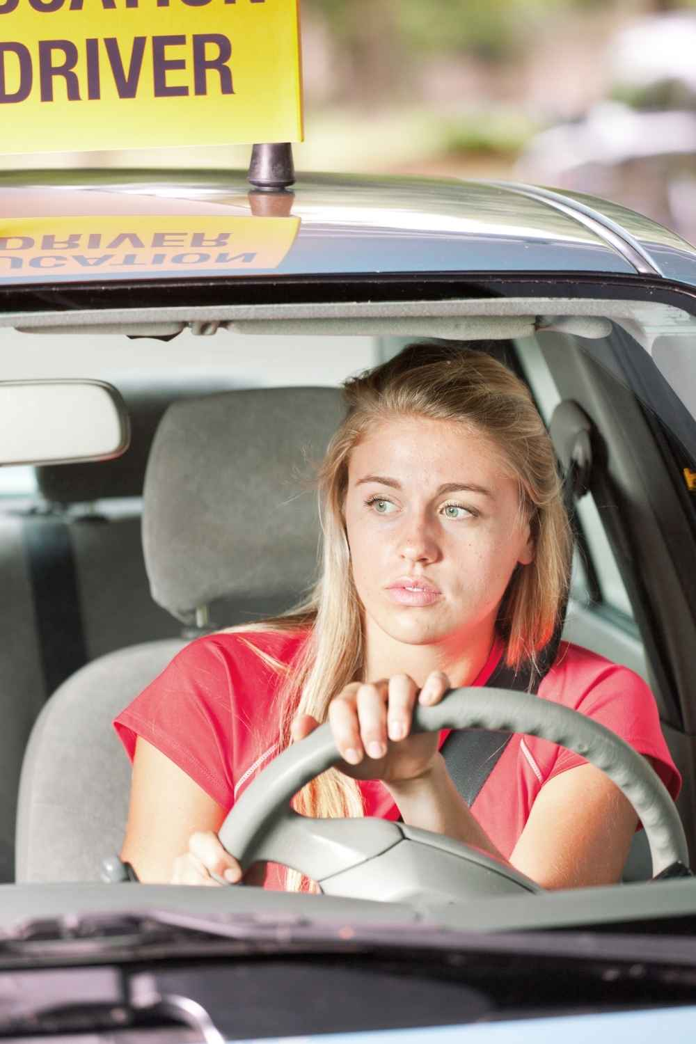 girl behind wheel of car learning how to drive with teen drivers eduction