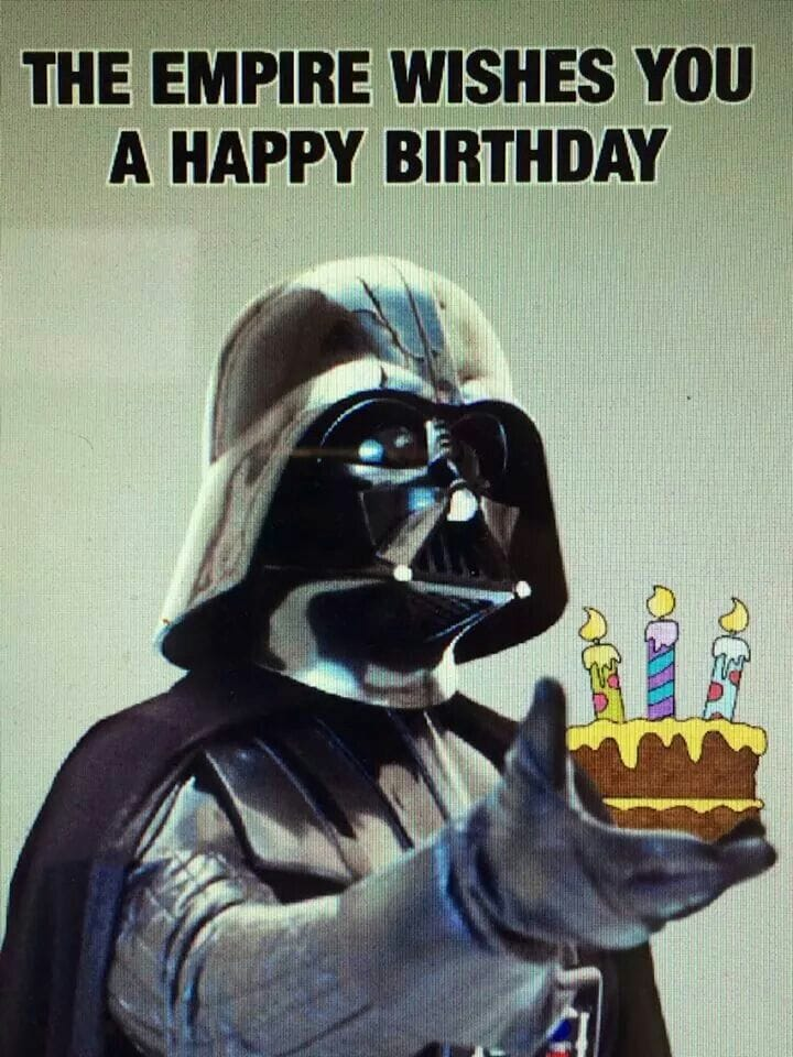 darth vadar holding a birthday cake
