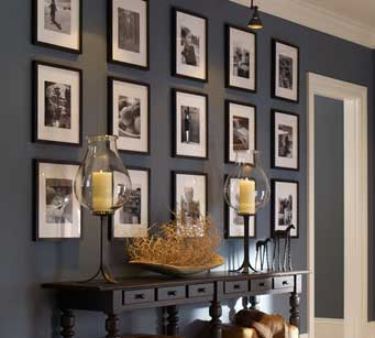 gallery wall photos black frames in hall way