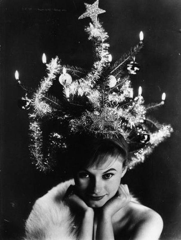 Talk about vintage glamour. She has her fur and hair in tinsel, literally. Christmas tree hairdo updo